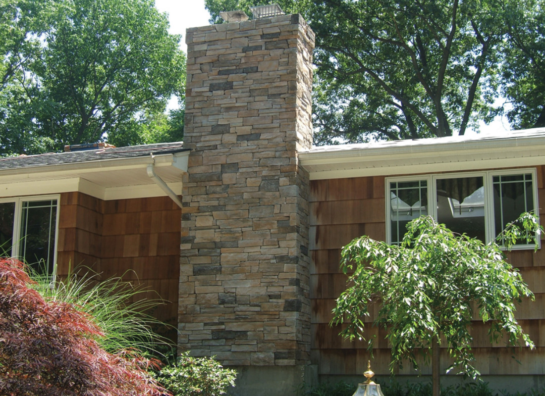 Chimney with stonework attached to house