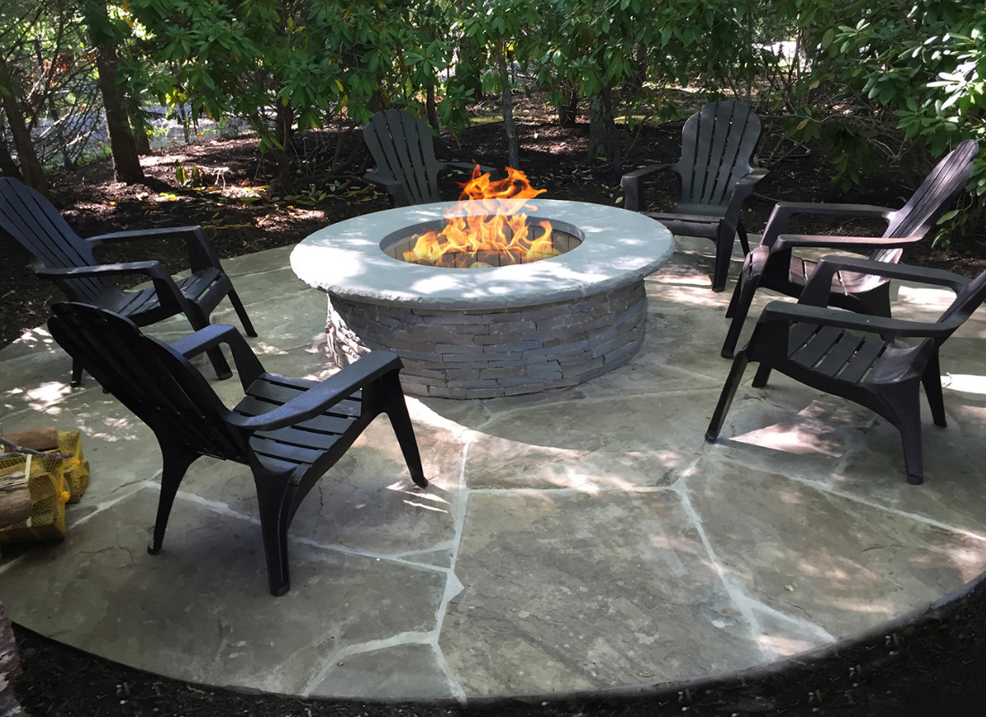Round fire pit with seating area