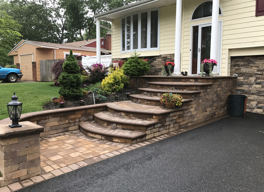 stone stops and steps extending to meet asphalt driveway