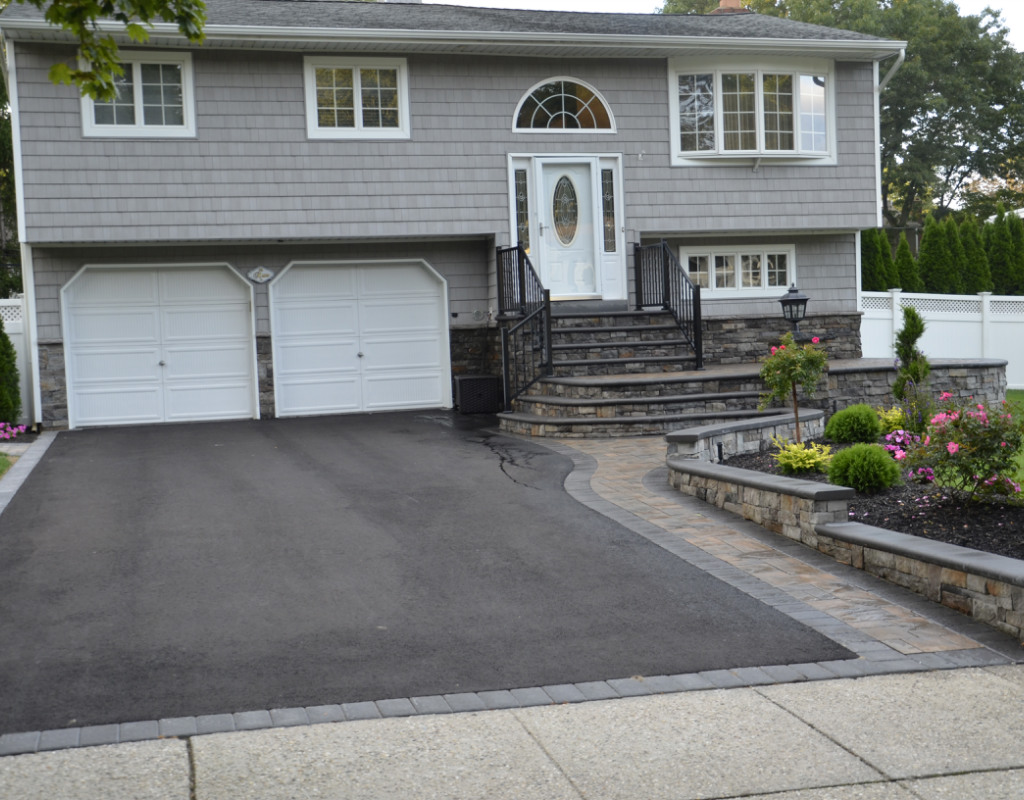 Paved driveway with stone walkway to the front door