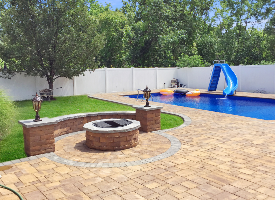 Patio around pool with fire pit and seating area