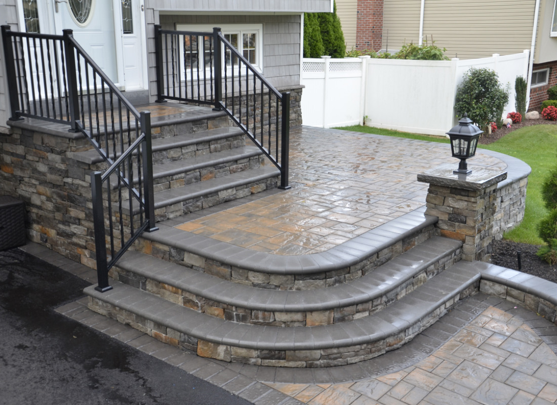 stoops and steps installed to connect with patio and driveway