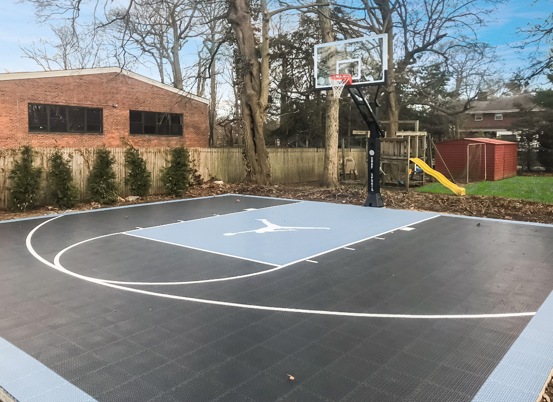 Half basketball court with the Air Jordan logo in the court