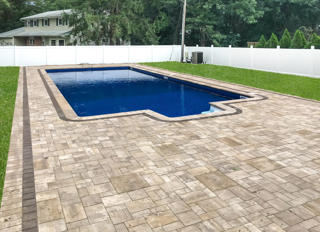 Deep blue lined pool with patio