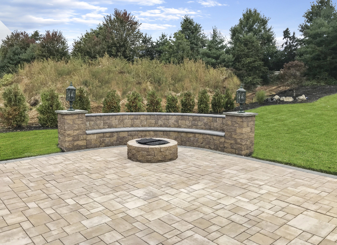 Beige paving stones used for seating area and fire pit