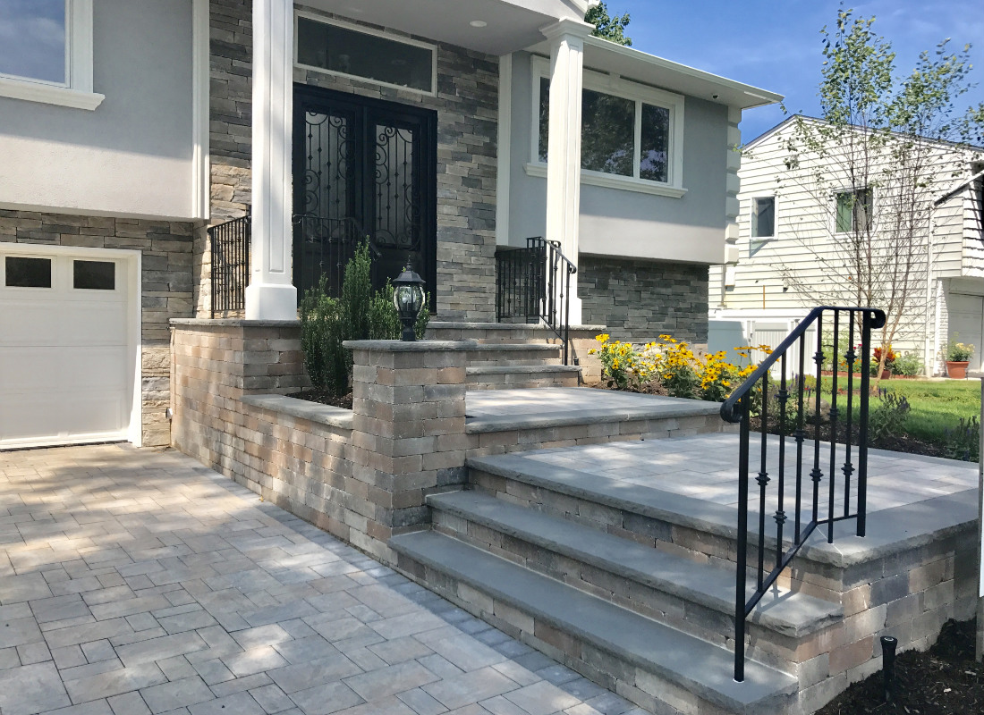 multi level steps and stoops leading down to a stone driveway