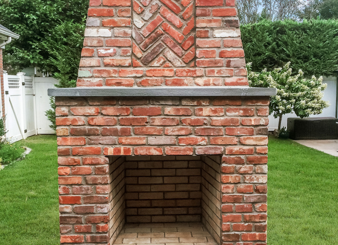Red brick chimney for outdoor fireplace
