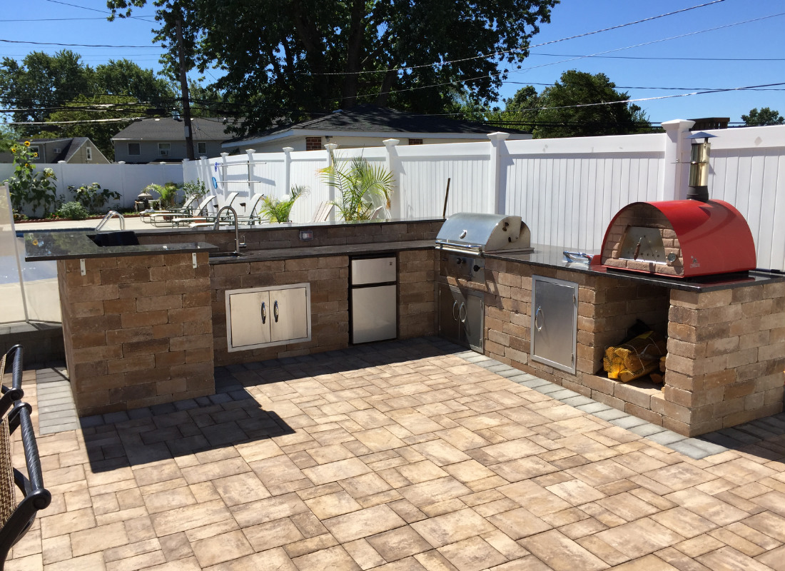 Large outdoor kitchen with wood burning stove