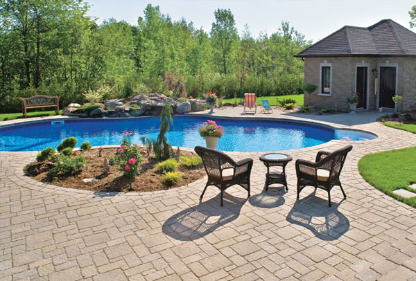 Backyard designed around pool to show poolscape services