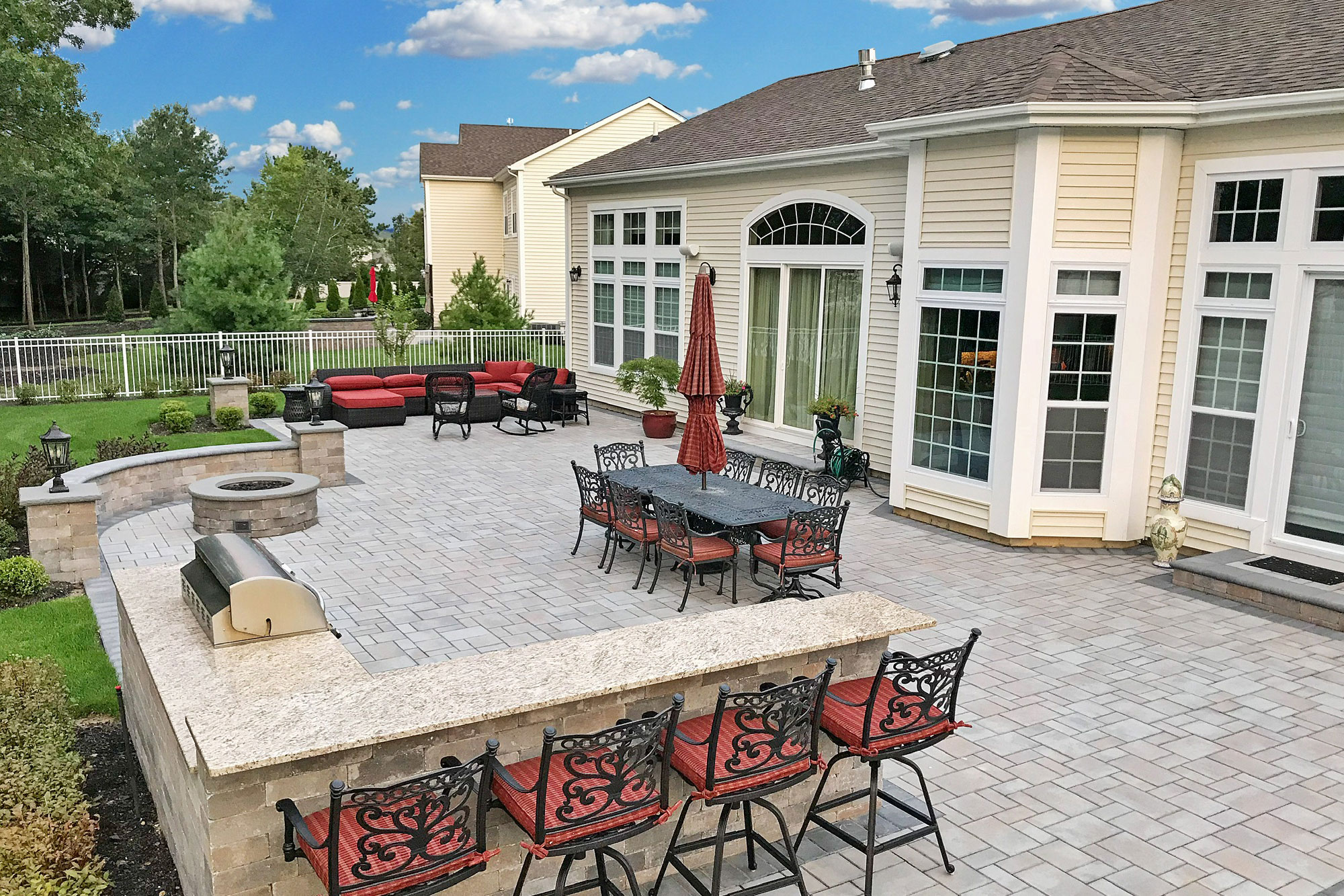 Patio designed with brickwork and outdoor kitchen