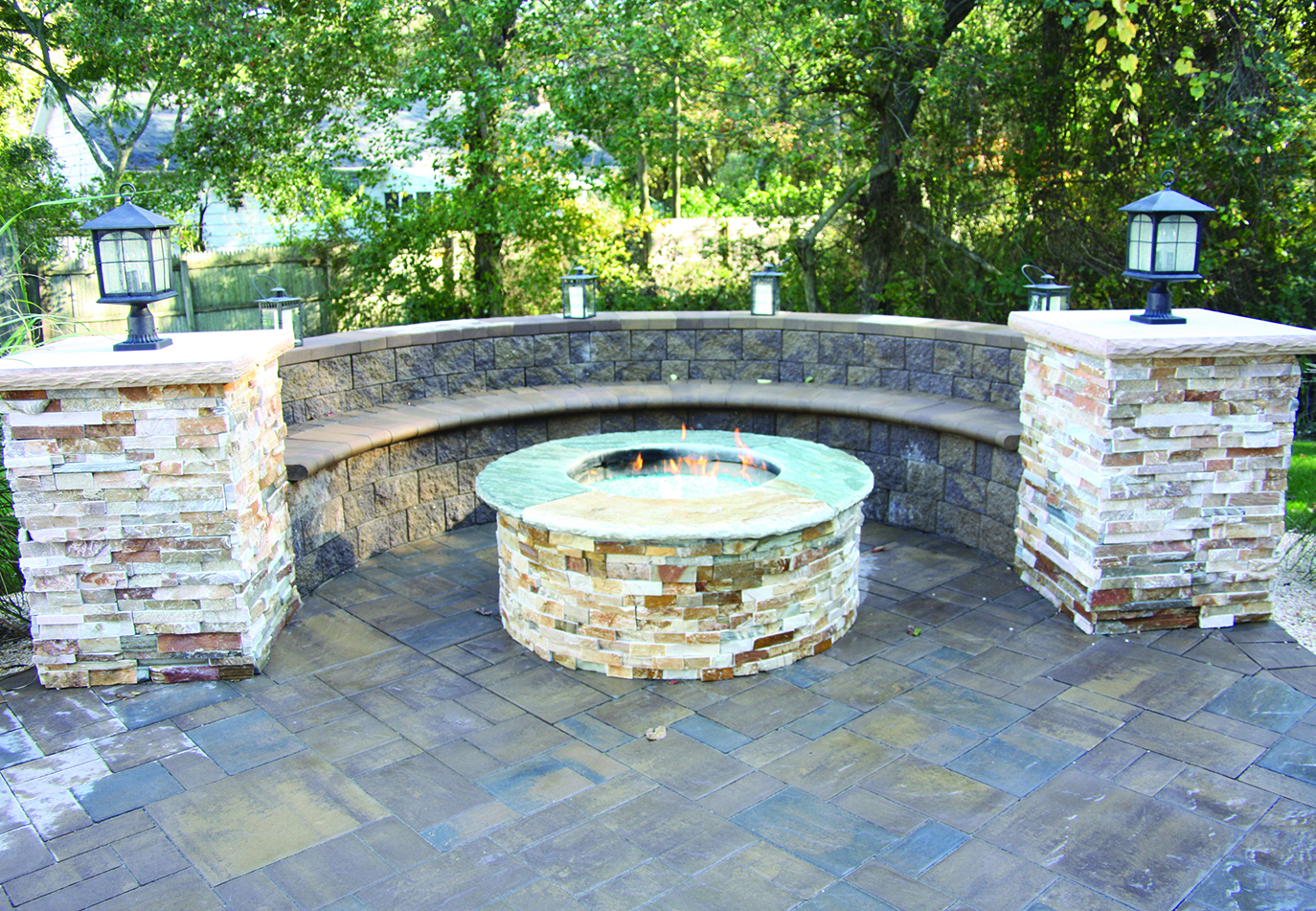 round fire pit with masonry seating area