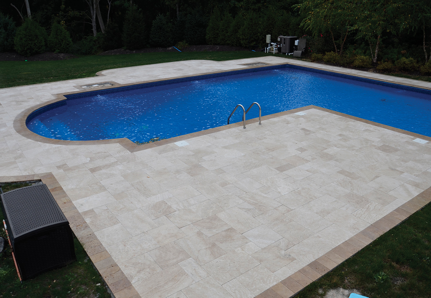 beige stone poolscape patio