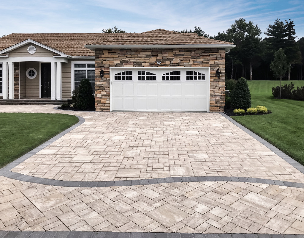 Beige stone driveway with simple design on the street end