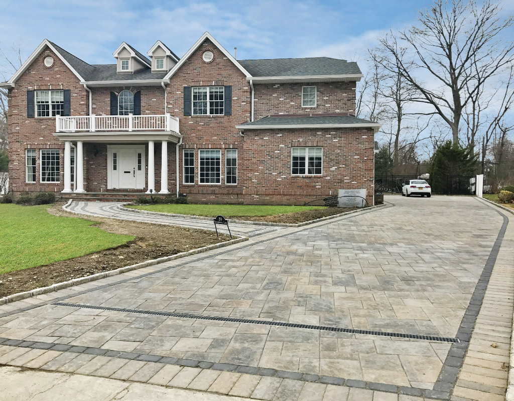 Long stone driveway with walkway to the front door