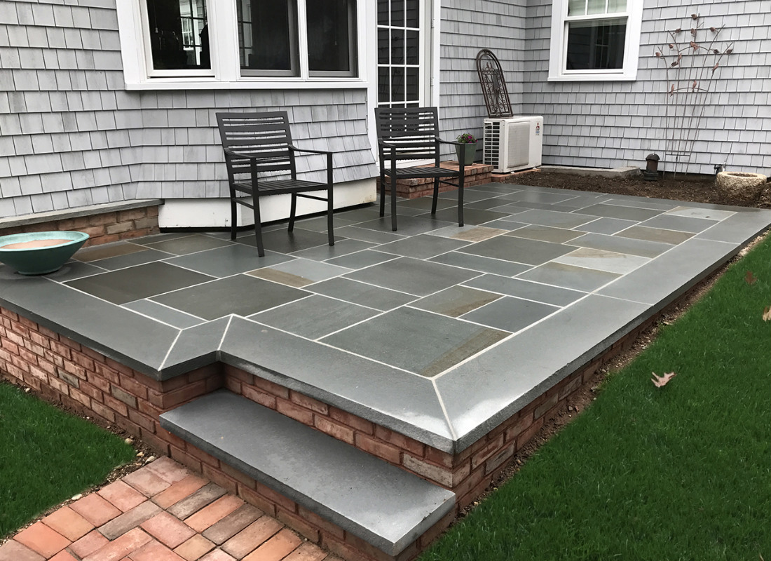 raised stone patio with brick perimeter