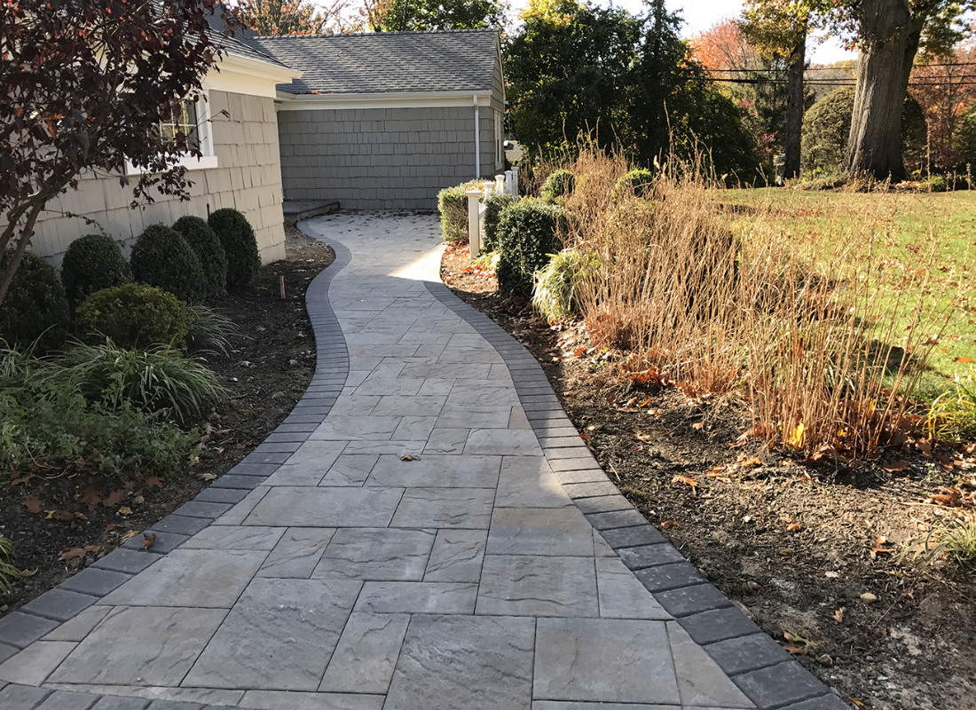 long walkway paved from driveway to front door