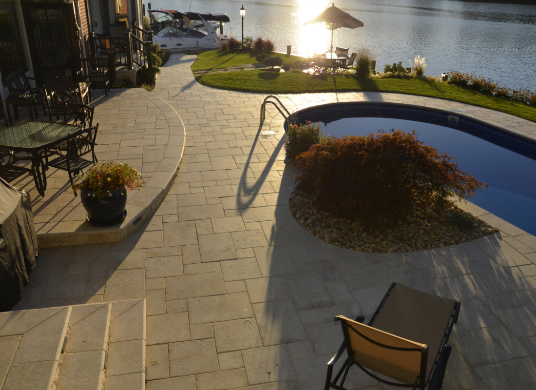 Stone patio with elegant landscape design