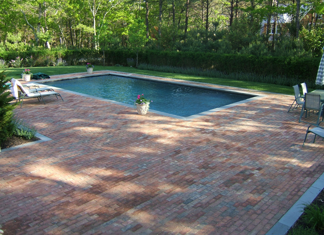 Traditional red brick around rectangle pool