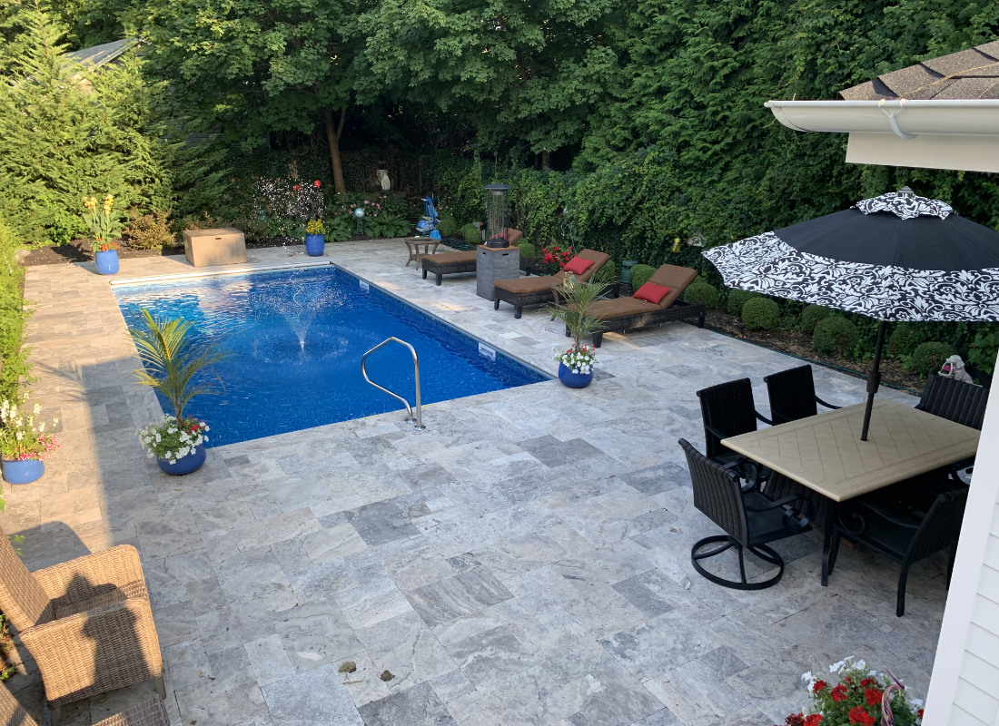 slate stone patio around in ground pool