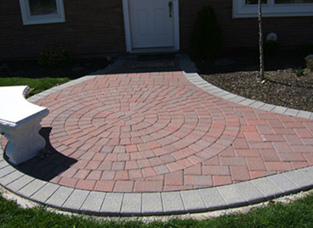 red brick walkway in round design