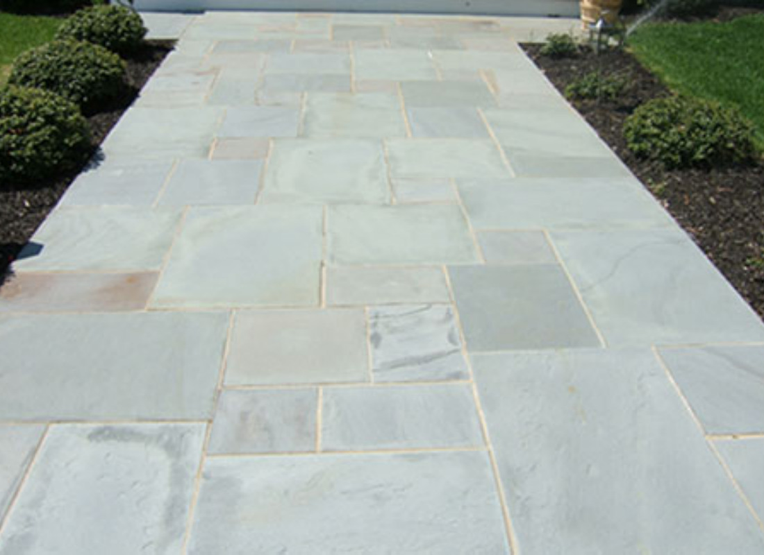 pale stone walkway to front door of house