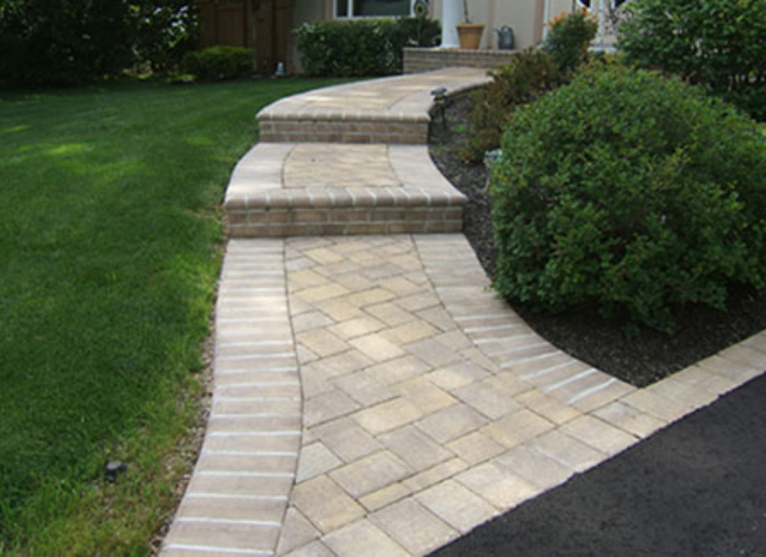 stone walkway from asphalt driveway with two steps