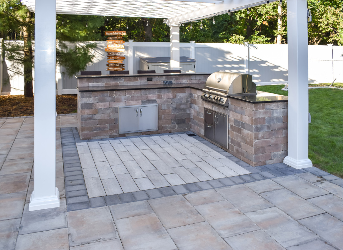 L-shaped outdoor kitchen with bar seating