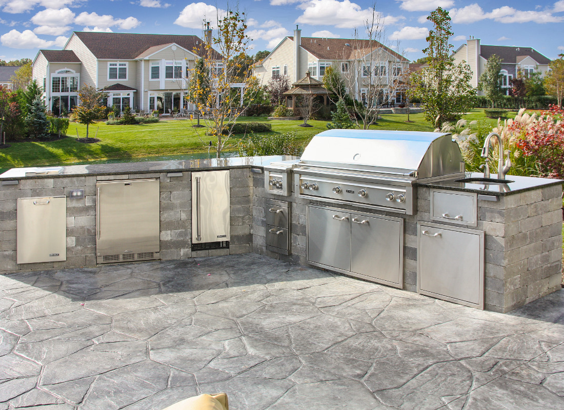 sleek outdoor kitchen with gray stone