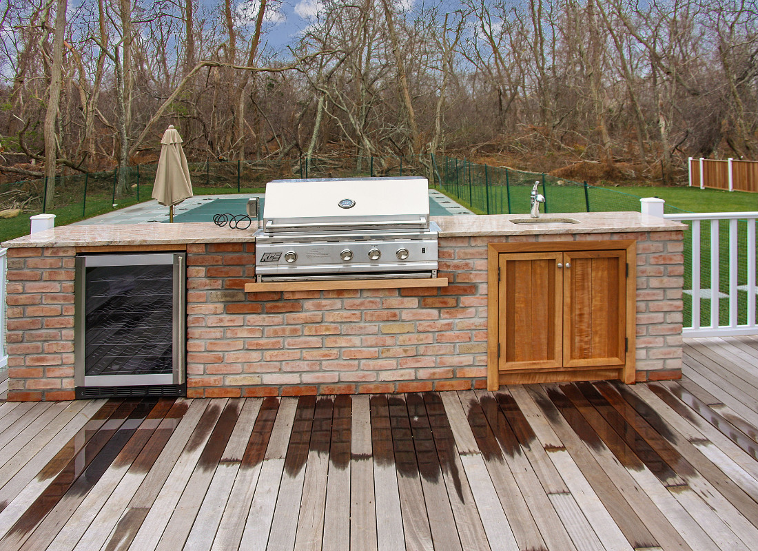 simple rustic outdoor kitchen with red brick
