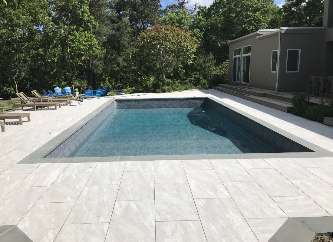 Modern gray brickwork around pool