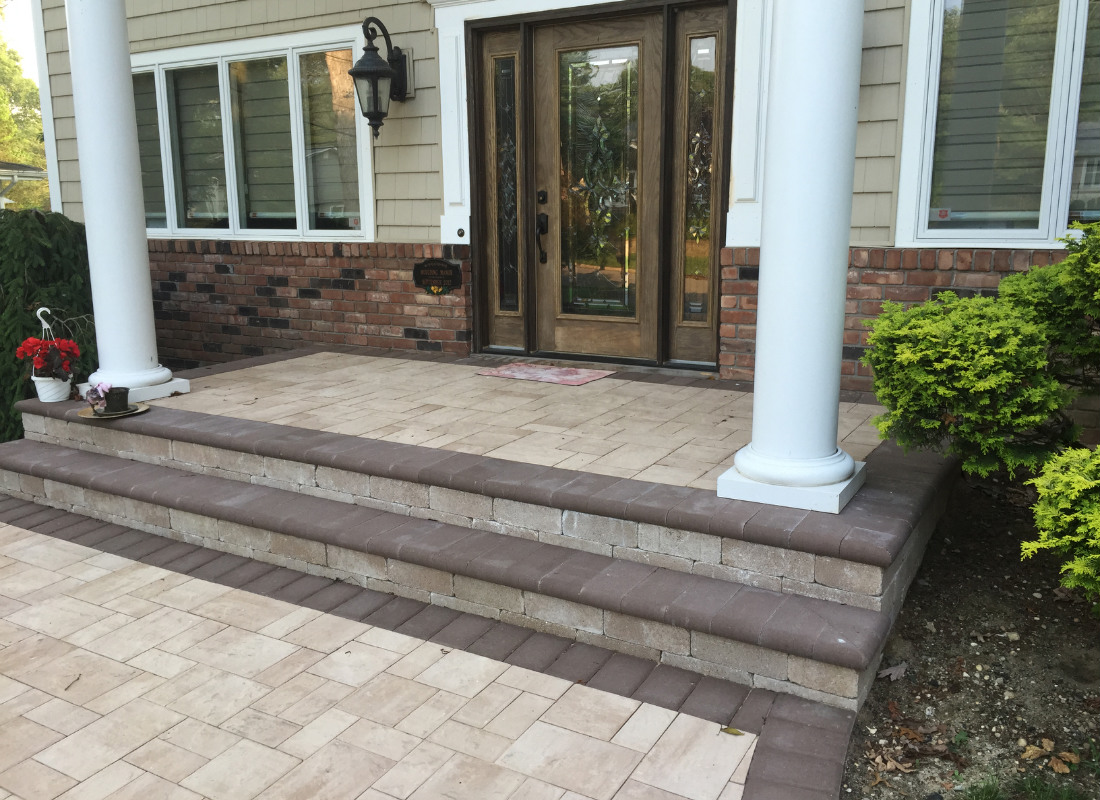 beige stone stoop with two steps down