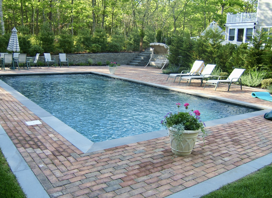 Traditional bricks surrounding rectangular unground pool